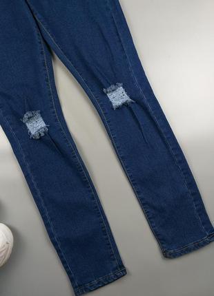 Джинсы высокие синие с дырками на коленках 12р.5 фото
