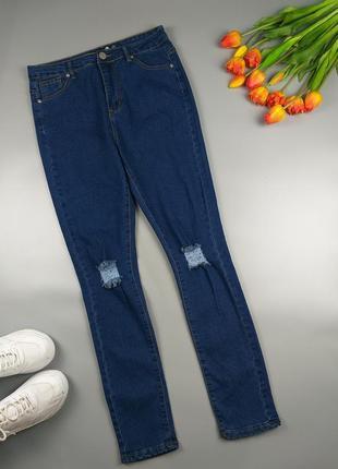 Джинсы высокие синие с дырками на коленках 12р.1 фото