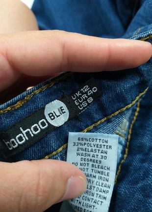 Джинсы высокие синие с дырками на коленках 12р.8 фото