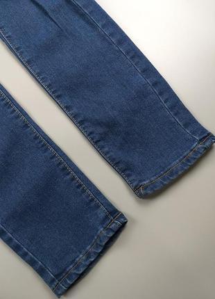 Джинсы высокие синие с дырками на коленках 12р.7 фото