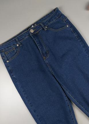 Джинсы высокие синие с дырками на коленках 12р.3 фото