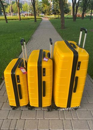 Качественный чемодан!!!полипропилен ,дорожная сумка ,сумка на колёсах ,надёжный ,двойные колеса,кодовый замок4 фото