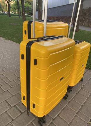 Качественный чемодан!!!полипропилен ,дорожная сумка ,сумка на колёсах ,надёжный ,двойные колеса,кодовый замок8 фото