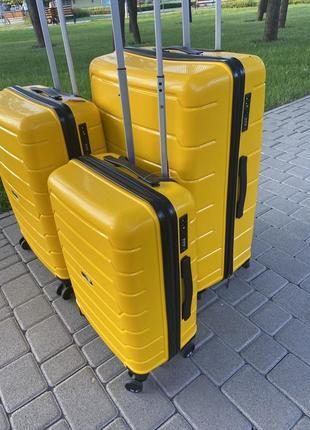 Качественный чемодан!!!полипропилен ,дорожная сумка ,сумка на колёсах ,надёжный ,двойные колеса,кодовый замок9 фото
