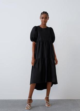 Широкое платье с оборками объёмными рукавами