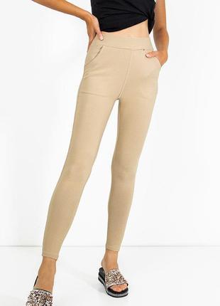 Бежеві жіночі легінси з кишенями