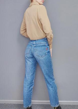 Блакитні вільні джинси з середньою посадкою