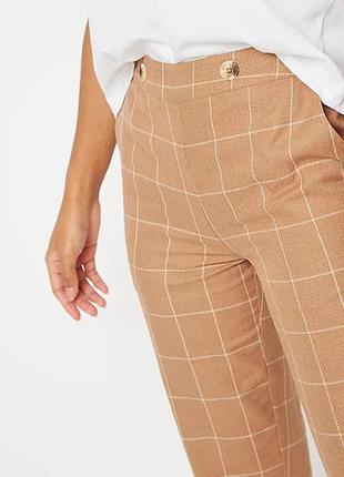 Модные зауженные брюки в клетку цвета camel р.22