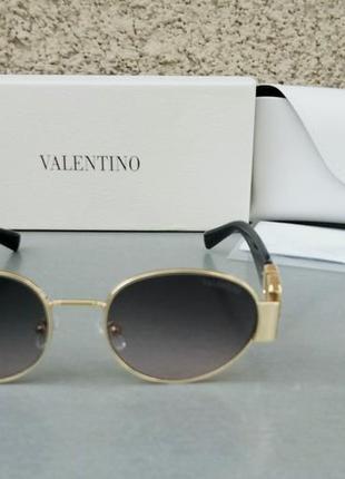 Valentino стильные женские солнцезащитные очки серо розовый градиент в золотом металле3 фото