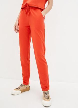 Оранжевые трикотажные брюки с высокой посадкой и завязками на поясе