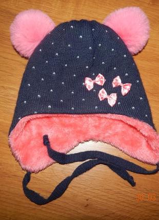 Теплая зимняя шапка на завязках