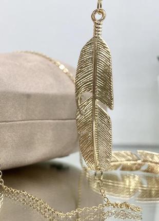Женская золотистая цепочка для очков с декором металлические перья по бокам