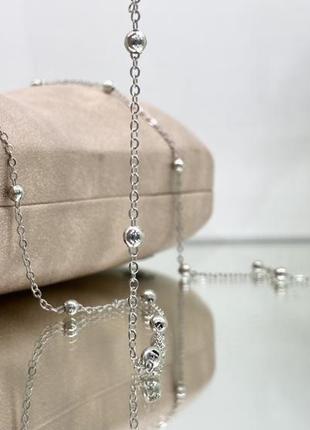 Серебристая цепочка для очков на силиконовых петлях с металлическими бусинками
