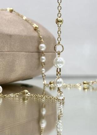 Женская цепочка для очков золотистая с бусинами на силиконовых петлях