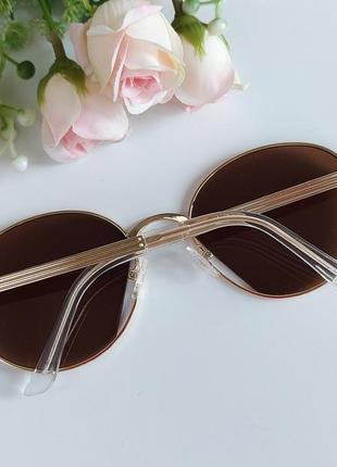 Солнцезащитные очки в коричневом цвете3 фото