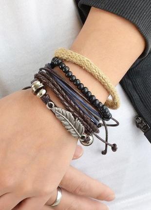 Крутой набор браслетов с пером в стиле бохо еко кожа бичевка перо браслет унисекс