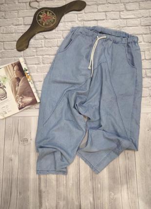Стильные джинсы с мотней на резинке
