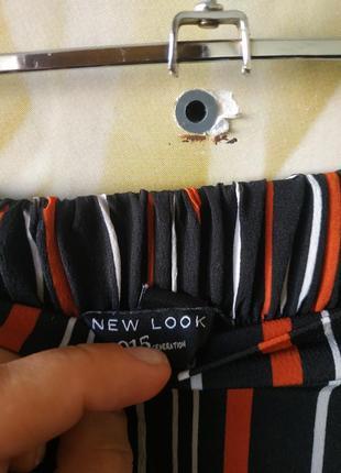 Стильные кюлоты в полоску с боковыми карманами5 фото