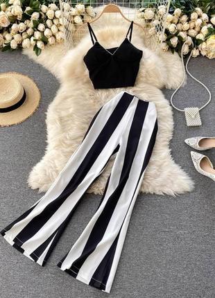 Шикарный костюм с топом и брюками клеш в полосочку