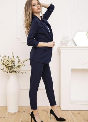 Женский костюм двойка пиджак и брюки цвет cиние