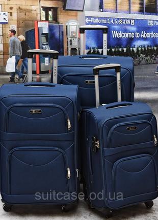 Тканевый дорожный чемодан на 4-х колесх ormi