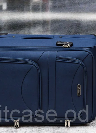 Тканевый дорожный чемодан на 4-х колесх ormi3 фото