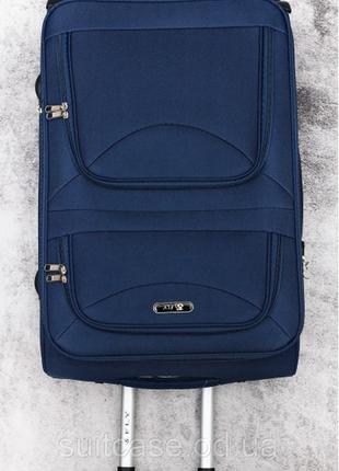 Тканевый дорожный чемодан на 4-х колесх ormi8 фото