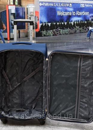 Тканевый дорожный чемодан на 4-х колесх ormi5 фото