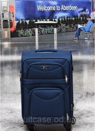 Тканевый дорожный чемодан на 4-х колесх ormi6 фото