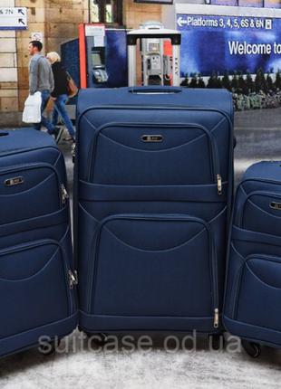 Тканевый дорожный чемодан на 4-х колесх ormi10 фото