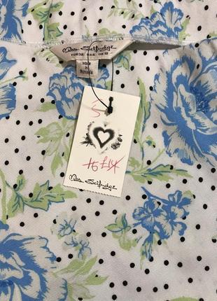 Очень красивая и стильная брендовая длинная юбка в горох и цветах..100% вискоза.