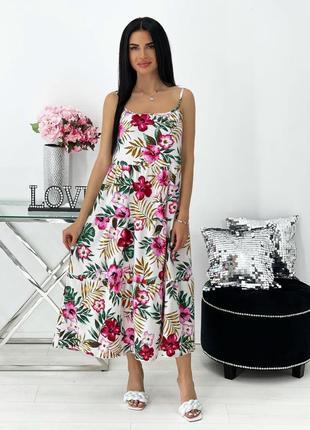 Женское платье на брительках с цветочным принтом3 фото