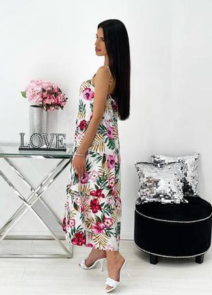 Женское платье на брительках с цветочным принтом2 фото