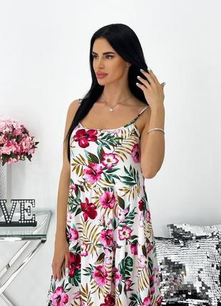 Женское платье на брительках с цветочным принтом4 фото