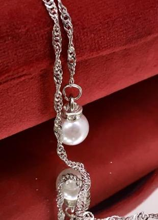 Женская цепочка для очков серебристая с подвесками жемчужинками3 фото