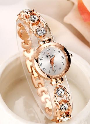Часы золотистые с кристаллами