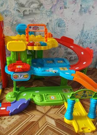 Развивающая игрушка гараж трек от vtech,озвучка на английском парковка