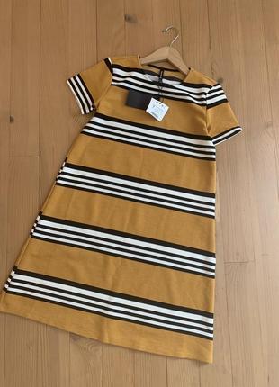 Гірчичне  плаття в смужку трикотаж stradivarius