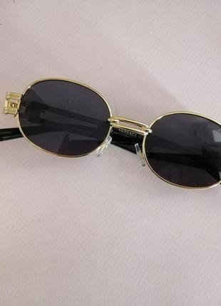 Эксклюзивные брендовые солнцезащитные женские чёрные очки в металлической оправе 20214 фото