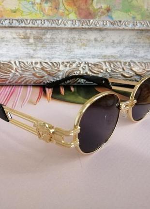 Эксклюзивные брендовые солнцезащитные женские чёрные очки в металлической оправе 20212 фото