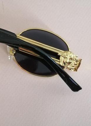 Эксклюзивные брендовые солнцезащитные женские чёрные очки в металлической оправе 20215 фото