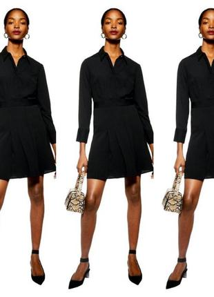 Платье рубашка чёрного цвета.