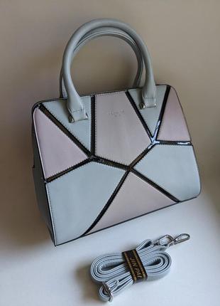 Стильная новая женская сумка голубого цвета