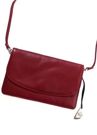 Шкіряна нова сумочка tula  3 відділення + 1 на замку  взаді теж карман на замку  270 грн  23 на 14.5см