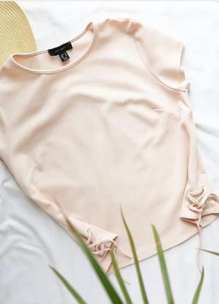 Блуза со шнуровкой по бокам
