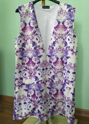 Оригінальне плаття-туніка з глибоким декольте