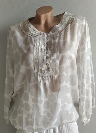 Брендовая блуза из натуральной ткани.