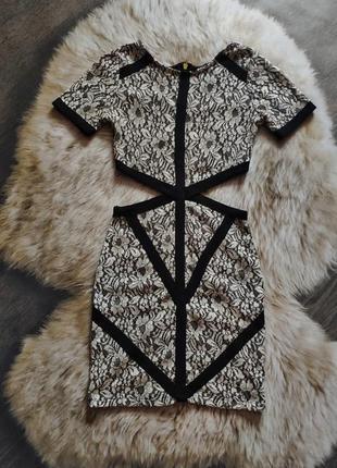 Шикарное кружевное платье с трендовыми вырезами