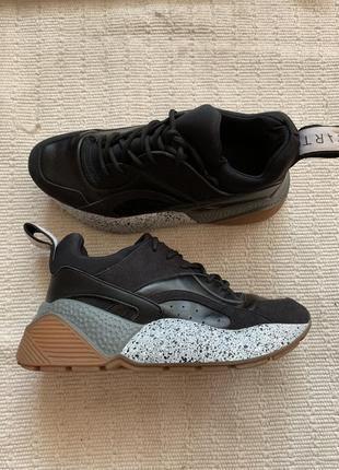Кроссовки  stella mccartney кроссовки чёрного цвета . кроссовки качественные недорого .