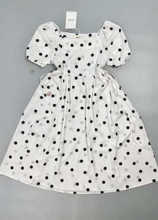Нова ніжна сукня довжини міді в горох